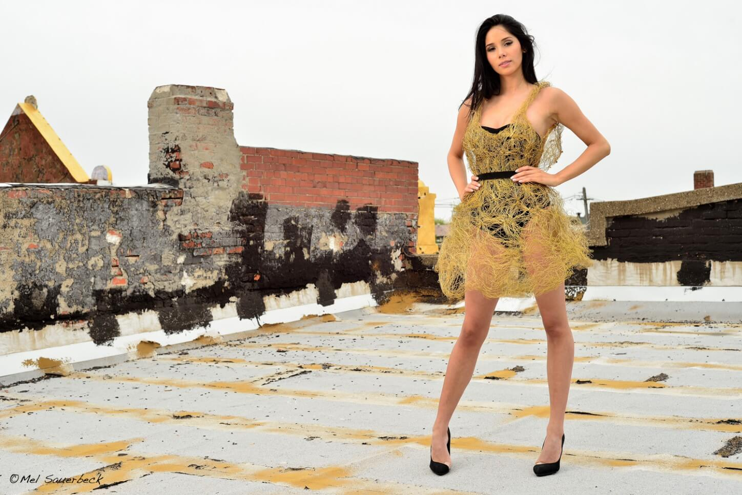Young woman in gold mesh on rooftop