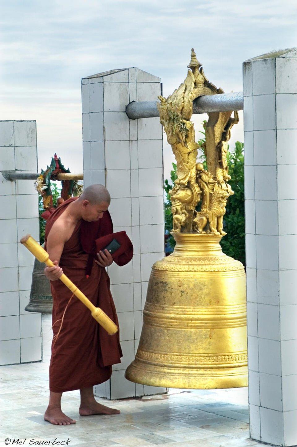 Monk ringing bell, Myanmar, Burma