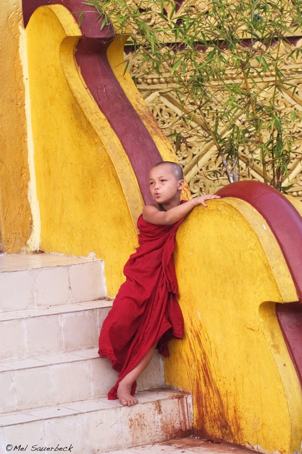 Young boy monks at entrance to temple, Myanmar, Burma