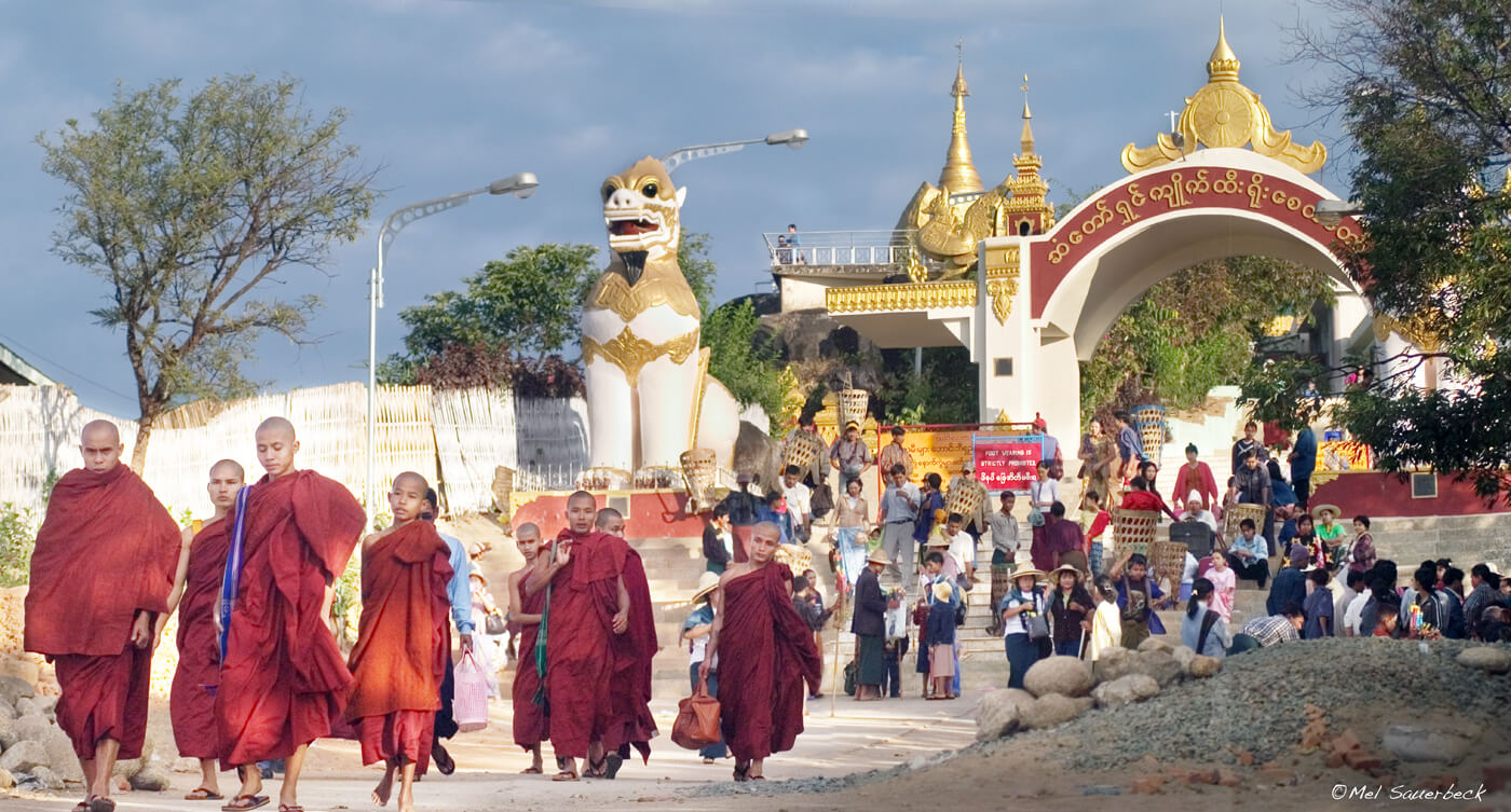 Monks at entrance to temple, Myanmar, Burma