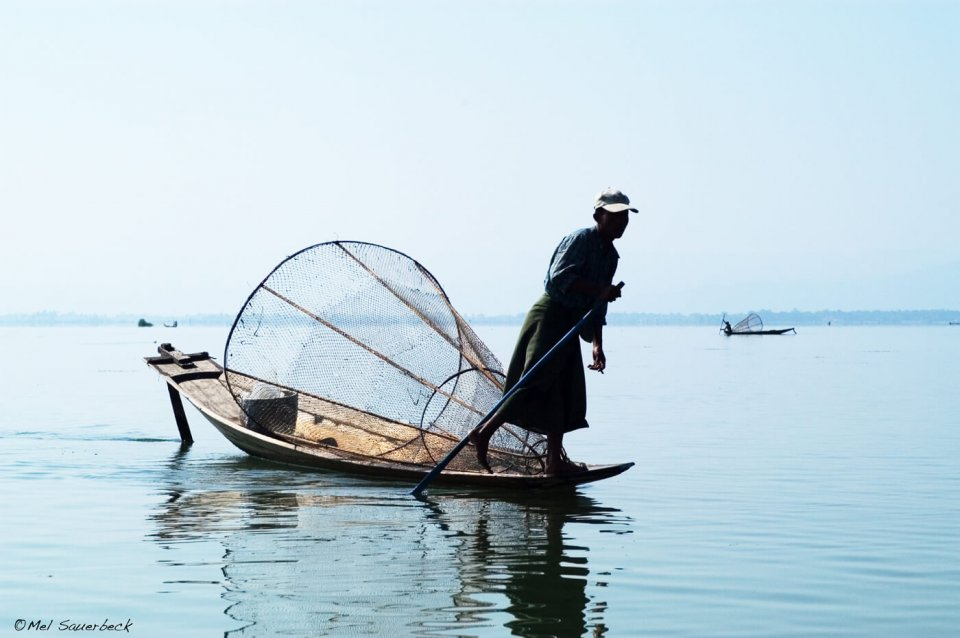 Man on boat, Inlay Lake, Myanmar, Burma