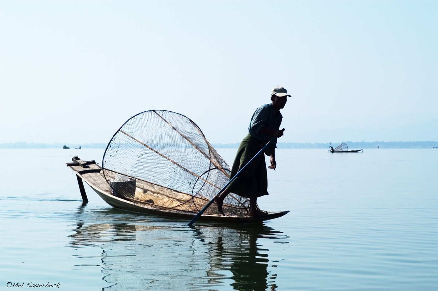 Man on boat, Inlay Lake, Myanmar, Burma