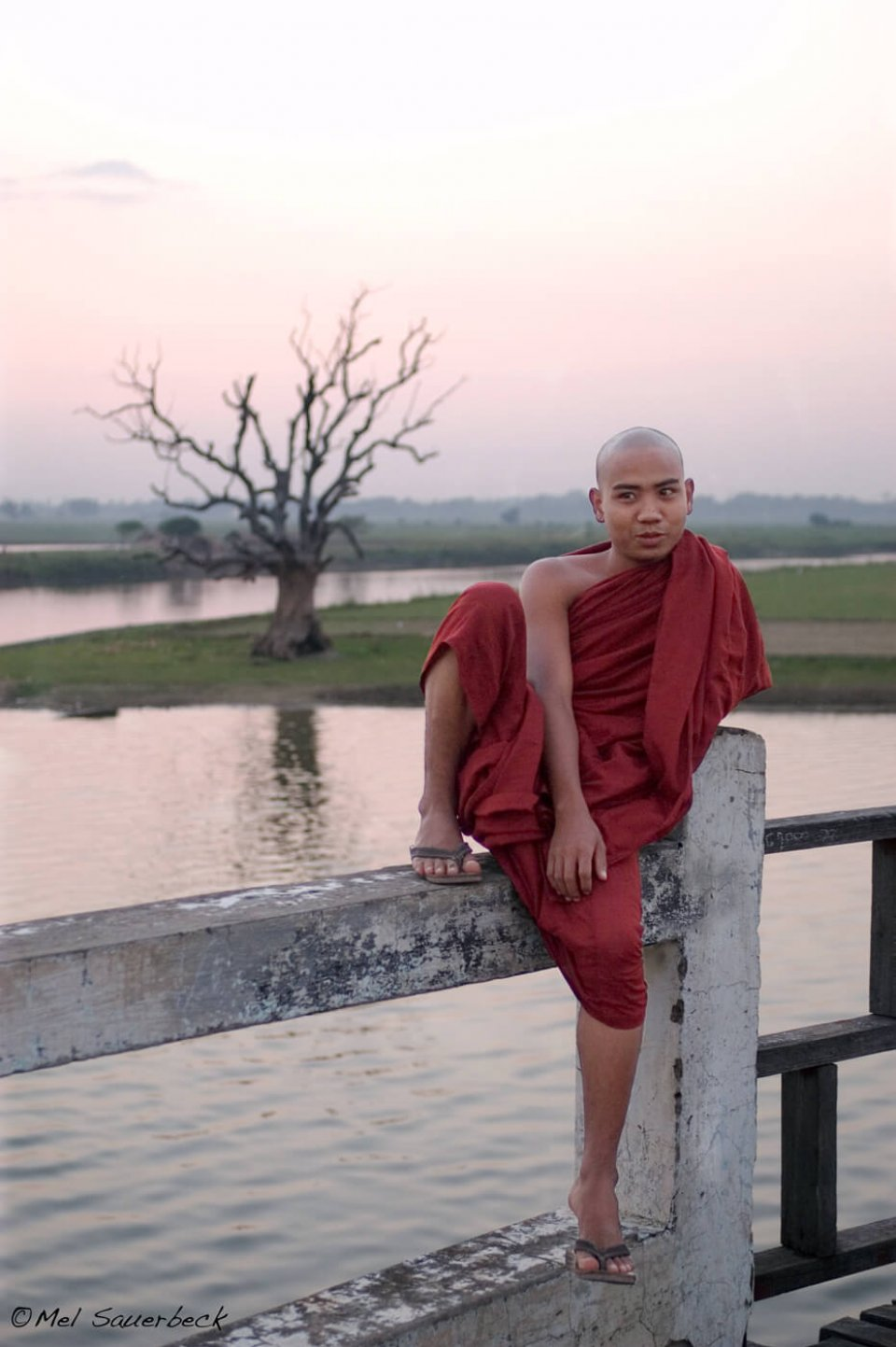 Young monk on bridge, Myanmar, Burma