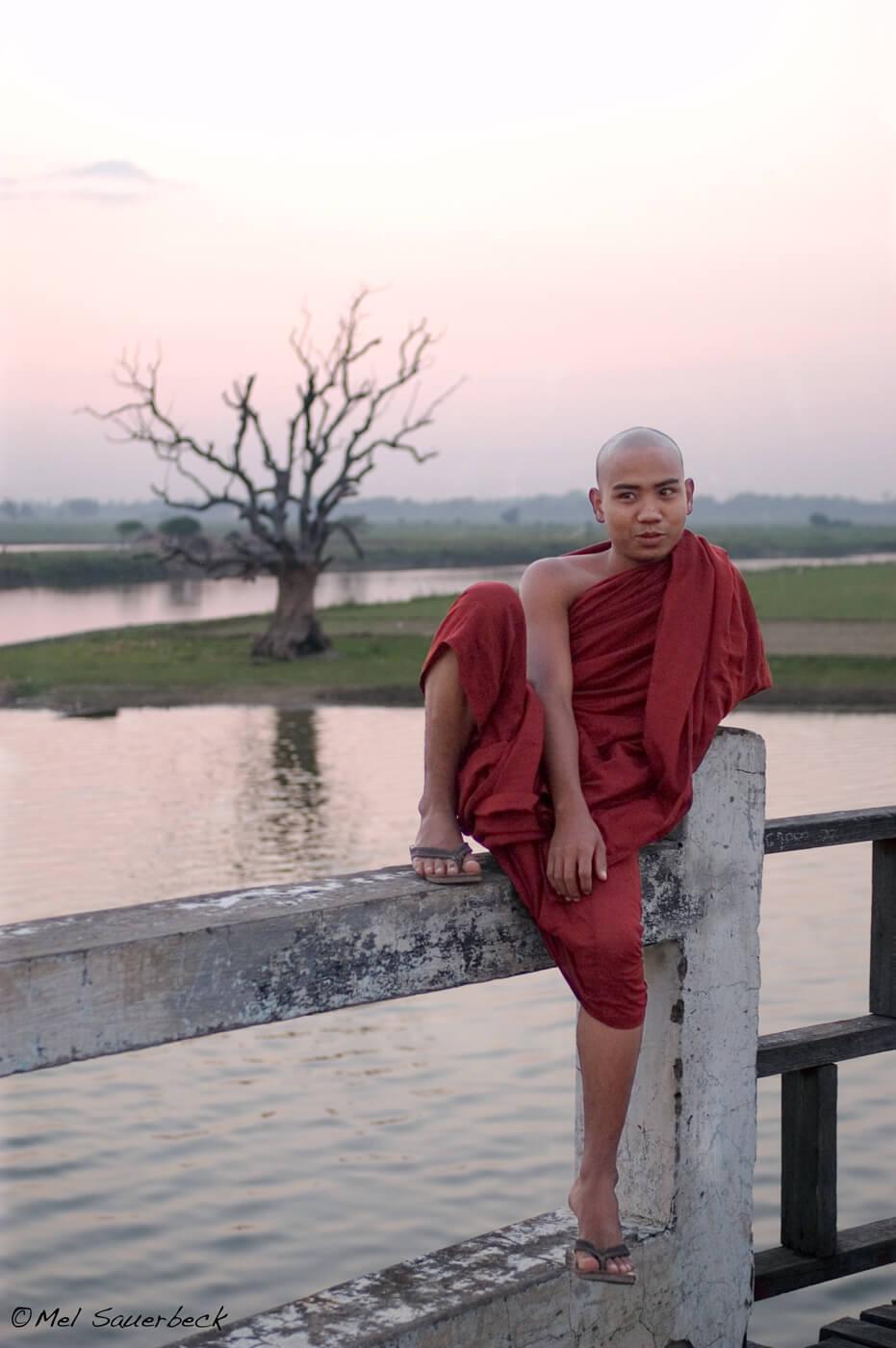Young monk on bridge, Myanmar, Burma
