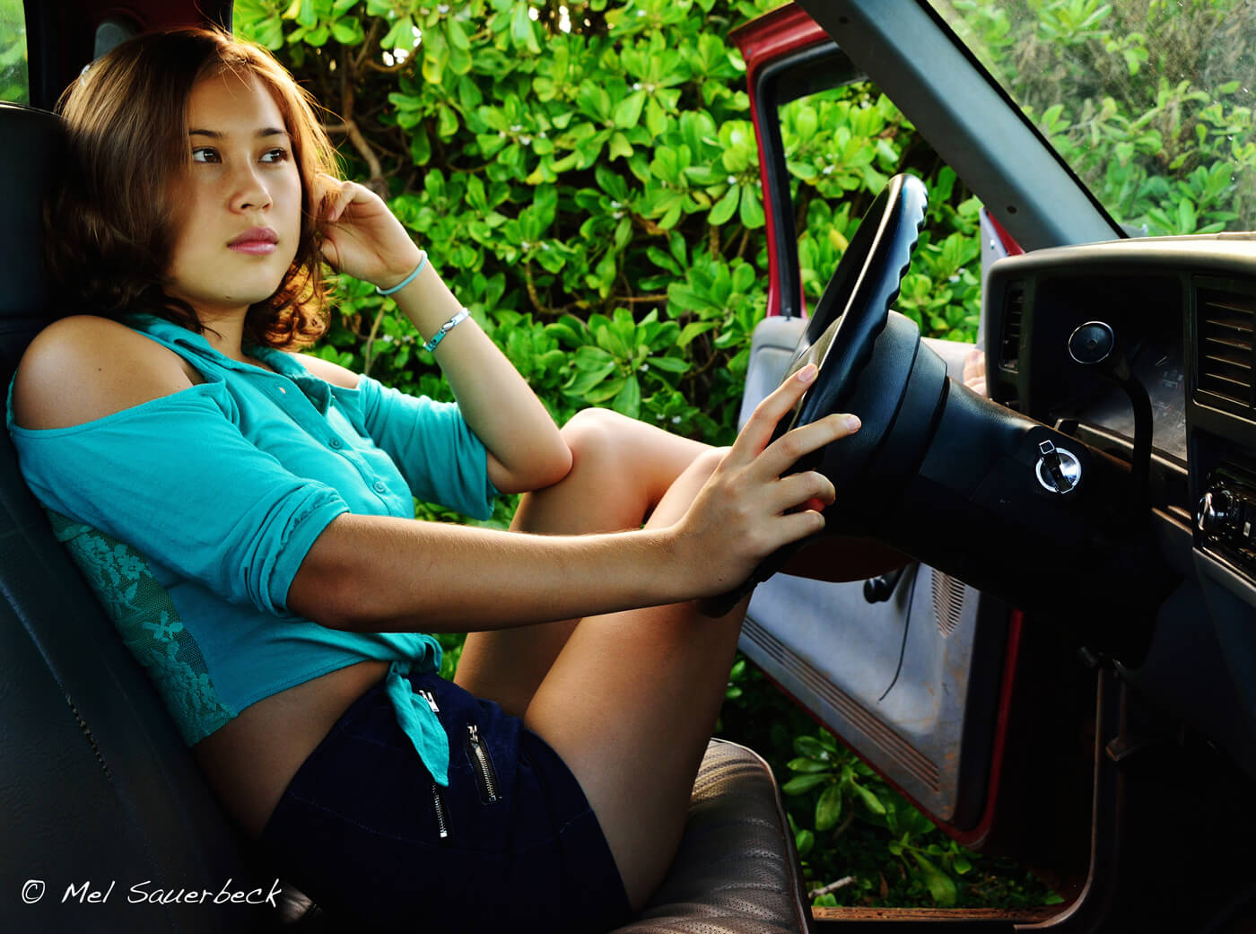 Young woman in old truck, Hawaii