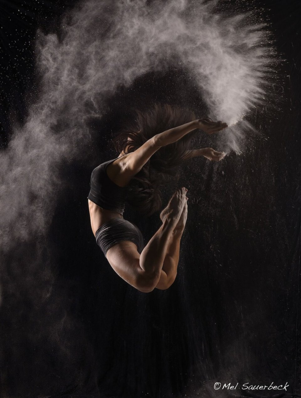 Young woman, flying powder jump