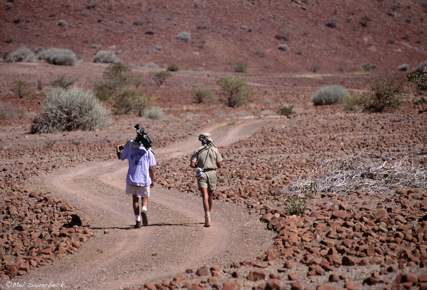 Photographers walking track in Namibia